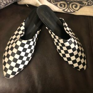 Black and white checkered mules